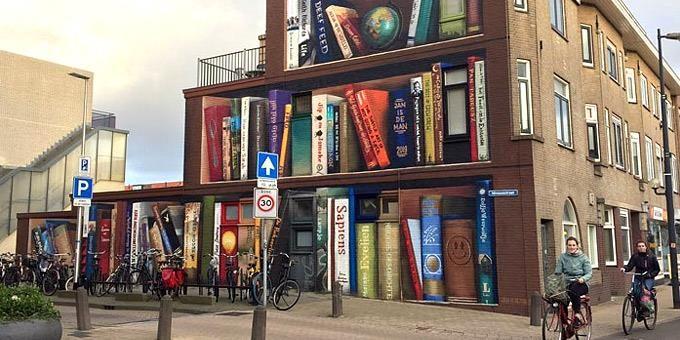 Καλλιτέχνης μεταμορφώνει κτίρια σε… βιβλιοθήκες